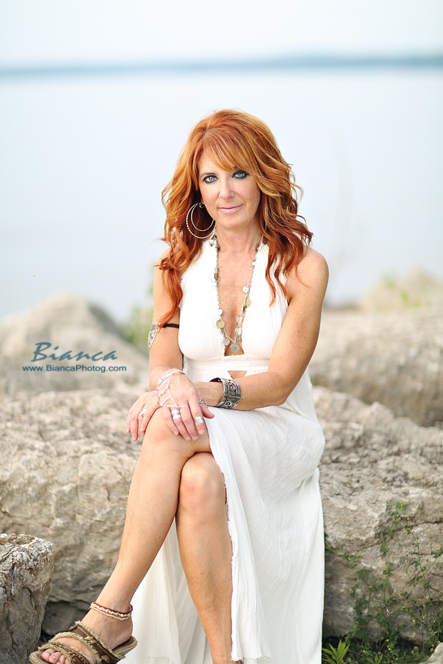 redhead in white dress in beach beauty shoot