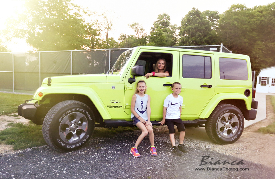 Family around Jeep