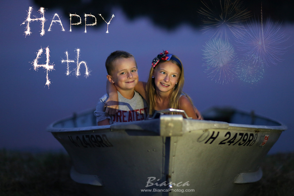 Brother and Sister in boat 4th of July