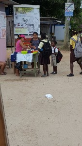 school kids buying lunch from street vendor