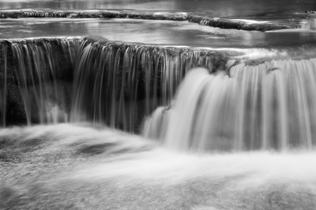 weir on the river black and white