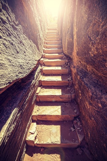 Retro Toned Stairs Carved In Stone With Sun At The End.