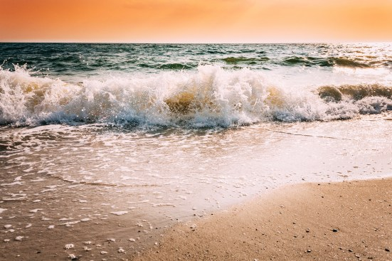 Sea Waves During Storm During Sunset Or Sunrise. Ocean Waves Was