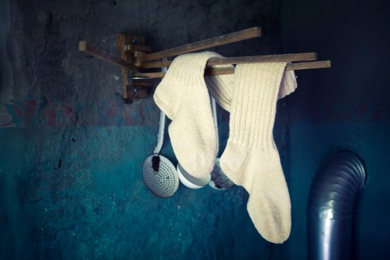 Old White Socks Hanging On Clothesline In Vintage Kitchen