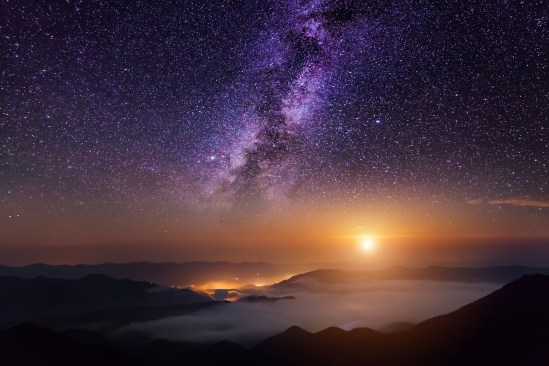 Mountain scene with twilight sky, Moon and shining stars of Milky Way.