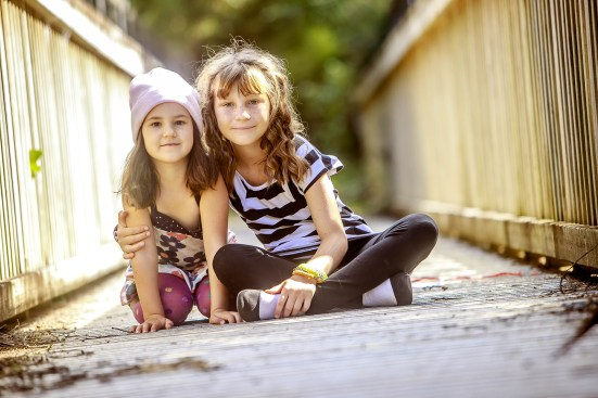 outdoor portrait of two young european girls on natural backgrou