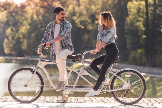Couple With A Tandem Bicycle