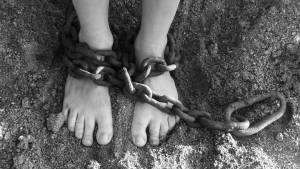 chains, feet, sand