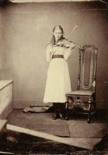 Victorian girl playing the violin 1878. Victorian music room dark music