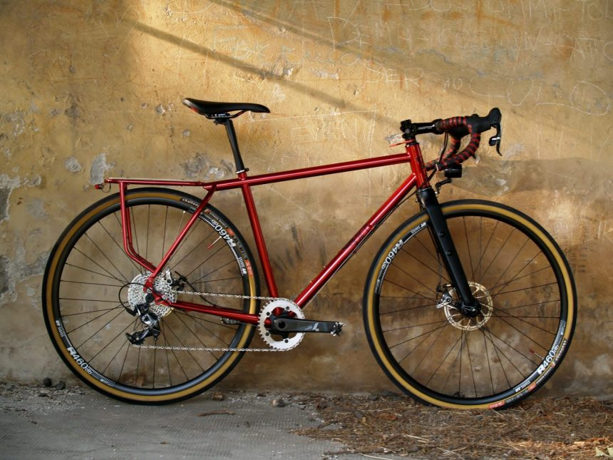 red bicebicycle frame in commuting version with integrated rear rack