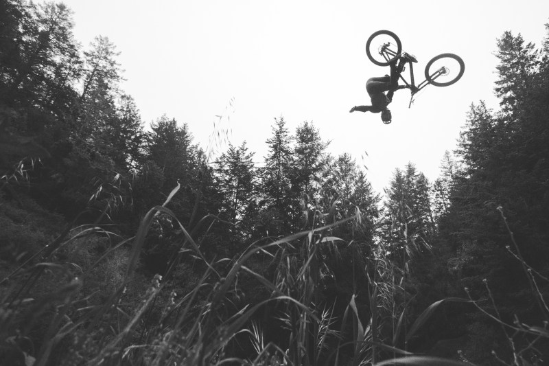Brandon Semenuk laying down a stylish one-handed 360 on the step up as seen on his Utah segment from Revel In The Chaos.