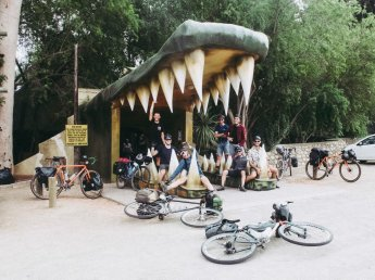 After escaping the jaws of hell we posed for our last group photo at the entrance to a zoo in Oudtshoorn © David Malan.