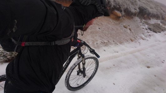 More hike-a-bike, this time in icy snow.