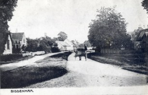 A cart passing between the school and the Three Tuns