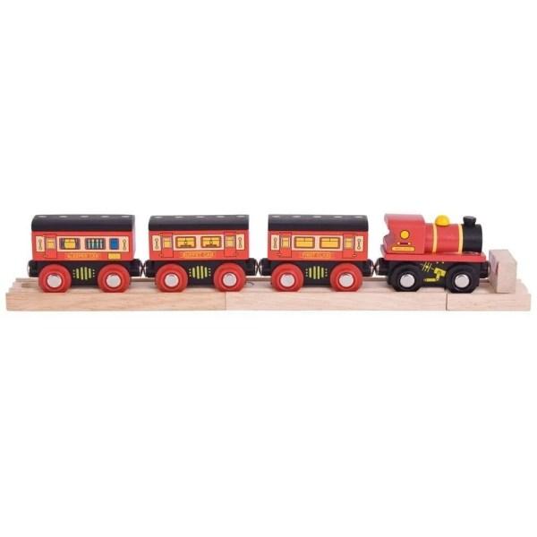 Ce train couchette en bois est un jouet pour enfant composé d'une locomotive, de 3 wagons couchettes, de 2 voies ferrées en bois et d'un butoir, soit 7 pièces en tout.