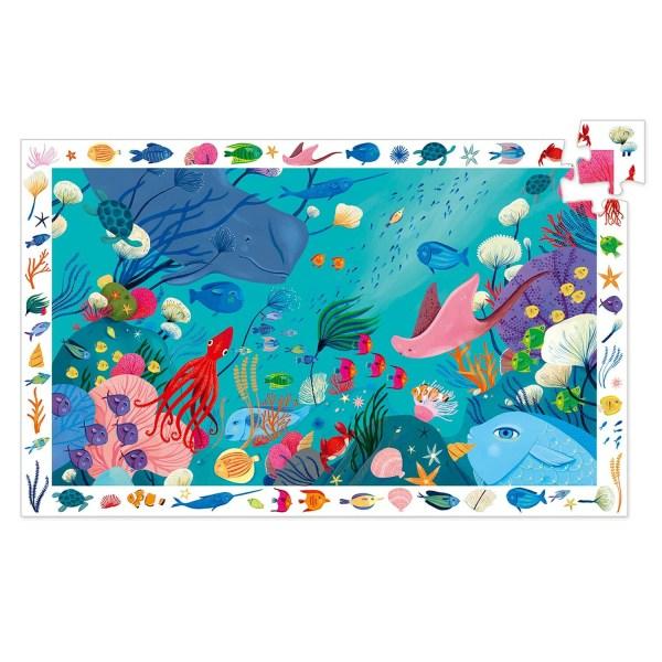 Puzzle observation Mer 54 pièces avec un dessin d'océan rempli d'animaux marin comme la baline, les poissons les raies ou les coraux
