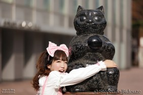 japanese girl and cat statue