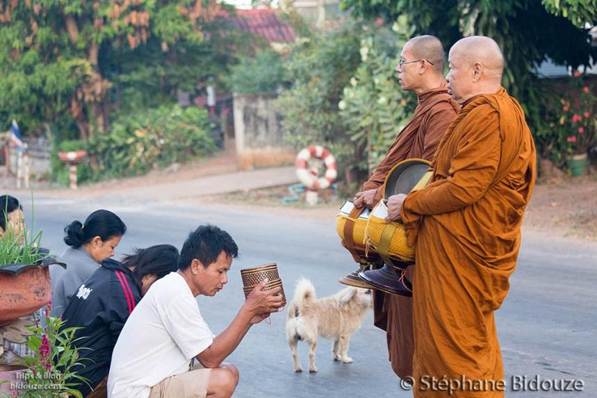 Monks praying at the morning alm
