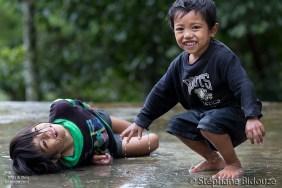 kids-playing-rain-under-filipino