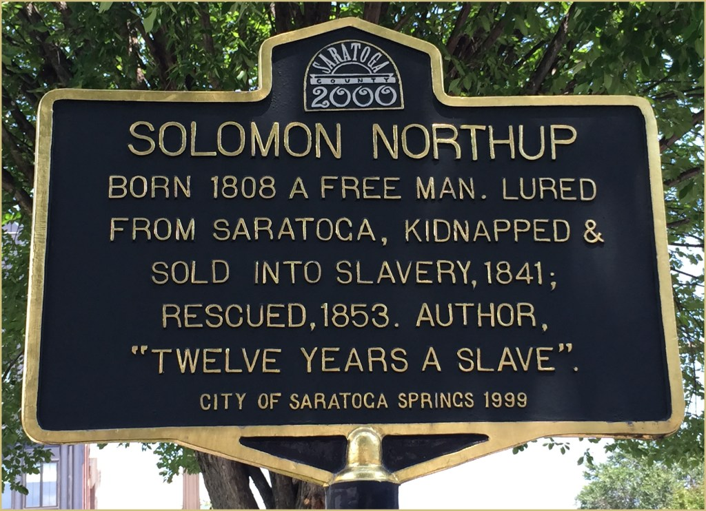 "Photo of a plaque reading, ""Solomon Northup."""