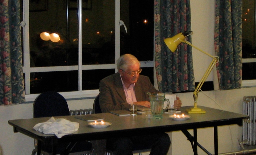 Photo of Peter Porter sitting at a table.