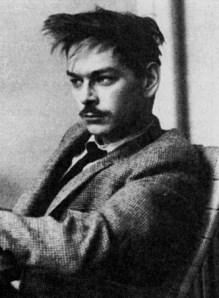 Lucien Carr in a suit and tie.