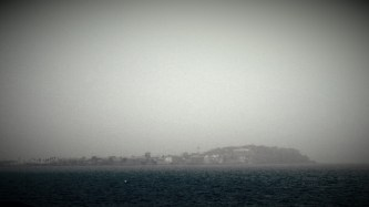 The Ile de Goree rises out of the fog