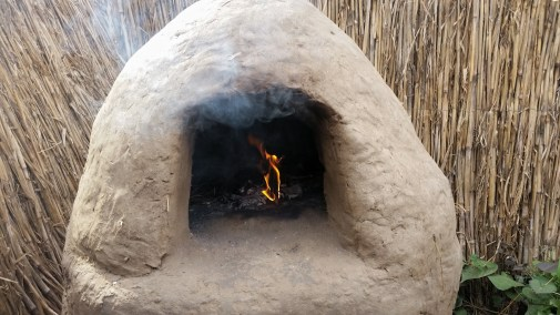 Warming up the mud oven for some baking