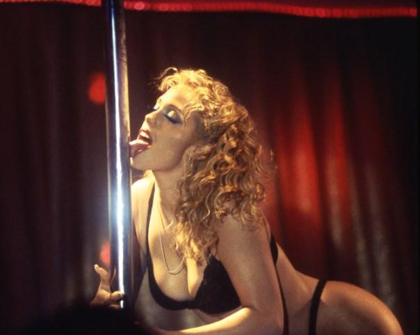 As dancer Nomi, Elizabeth Berkley proves winter or no, pole-licking is a bad idea.
