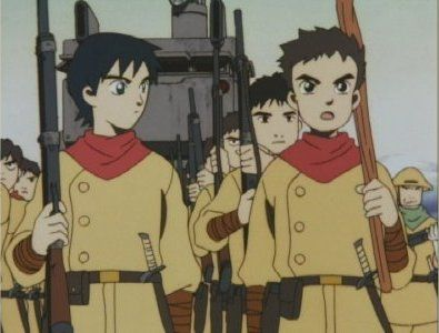 Shu (right), Nabuca, and their fellow child soldiers as they march out on a raid.