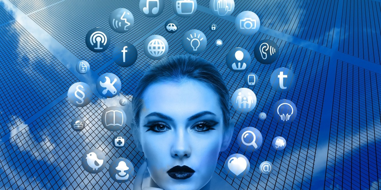 Magic & Media - a mystical woman with a halo of media icons