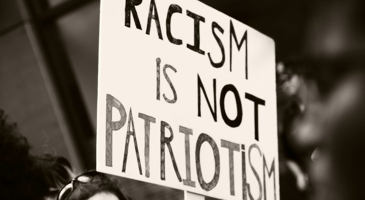 """Racism is not Patriotism"" protest sign"