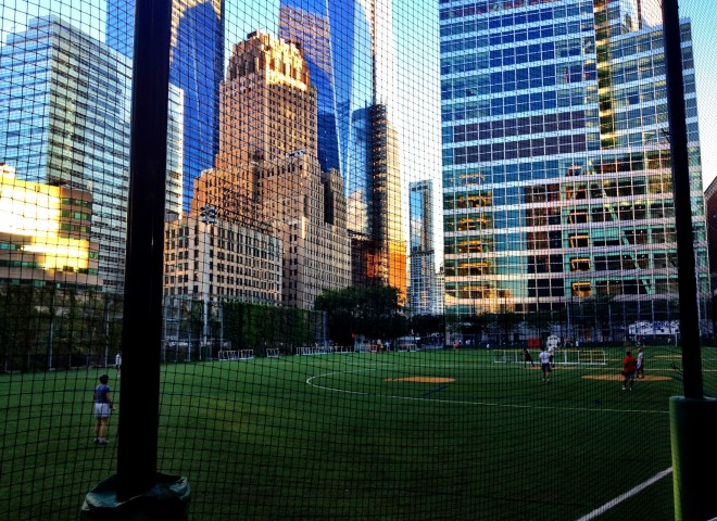 Sports fields surrounded by skyscrapers