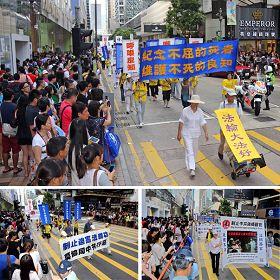 圖6.制止迫害的遊行,吸引廣大民眾和旅客的關心與圍觀,紛紛舉起相機、手機拍照。