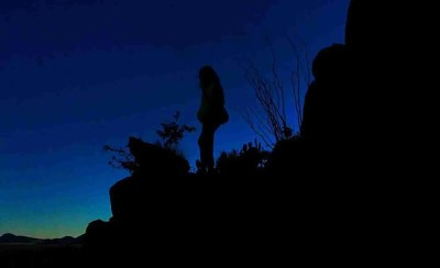 Standing around balanced rock in big bend at dusk