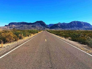 Driving in Big Bend National Park with Chisos Mountains in the back