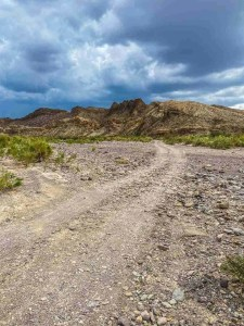 Old Maverick Road with rocky creek bed
