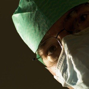 The Impact of negativity on labour and birth - close-cropped image of a masked doctor staring down at you.