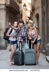 stock-photo-group-of-smiling-tourists-making-selfie-on-the-background-of-landmark-347767151