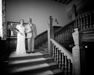 Image of bride and father on master staircase at Ashorne Hill