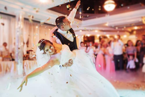 couple dancing at a wedding reception - Wedding Limos
