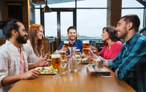 friends out eating at a bar - Nights Out