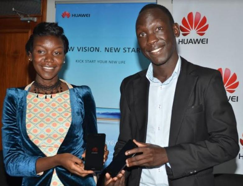 Jean Baguma (L) Huawei Uganda Marketing Manager and Sam Cris Ayo (R), Huawei Uganda Device Services Manager display the Huawei Y6II during the official launch.