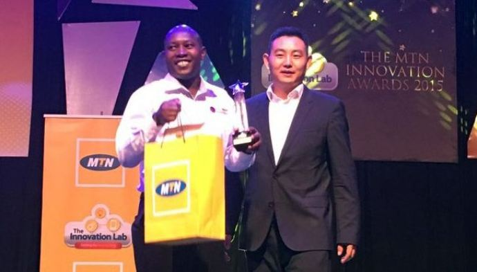 Wilson Kutegeka, one of the winners at a previous edition of the MTN Innovation Awards receiving his award.