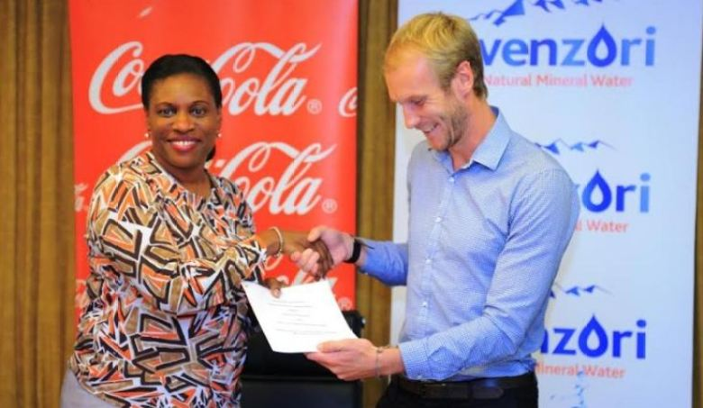 Norah Odwesso, CCBA Group Public Affairs and Communications Executive Director with Masaka Collection Centre, Director Andrew Bownds after signing the MoU.