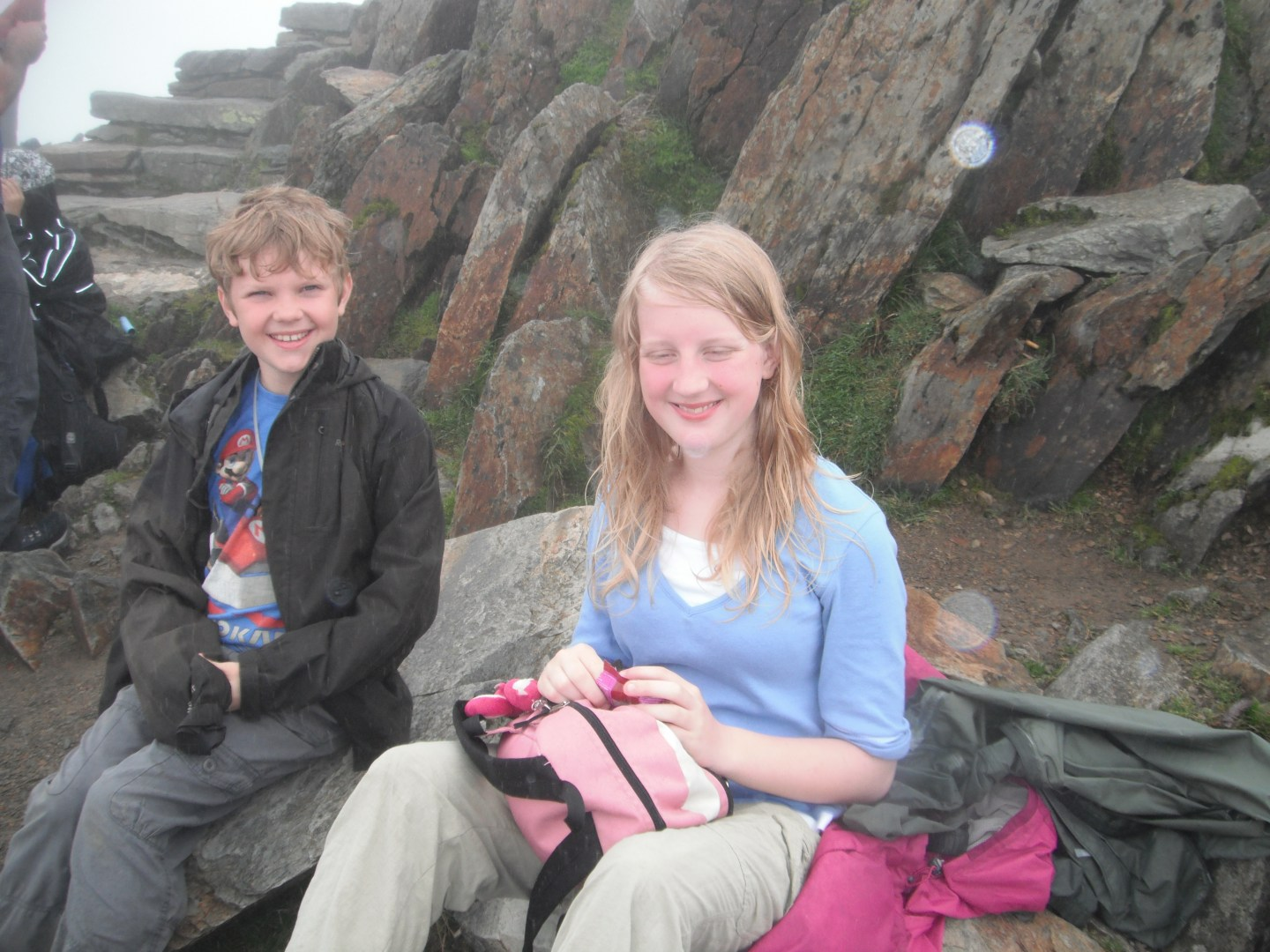 Xene and Lochlan eating lunch on the summit of Mount Snowdon