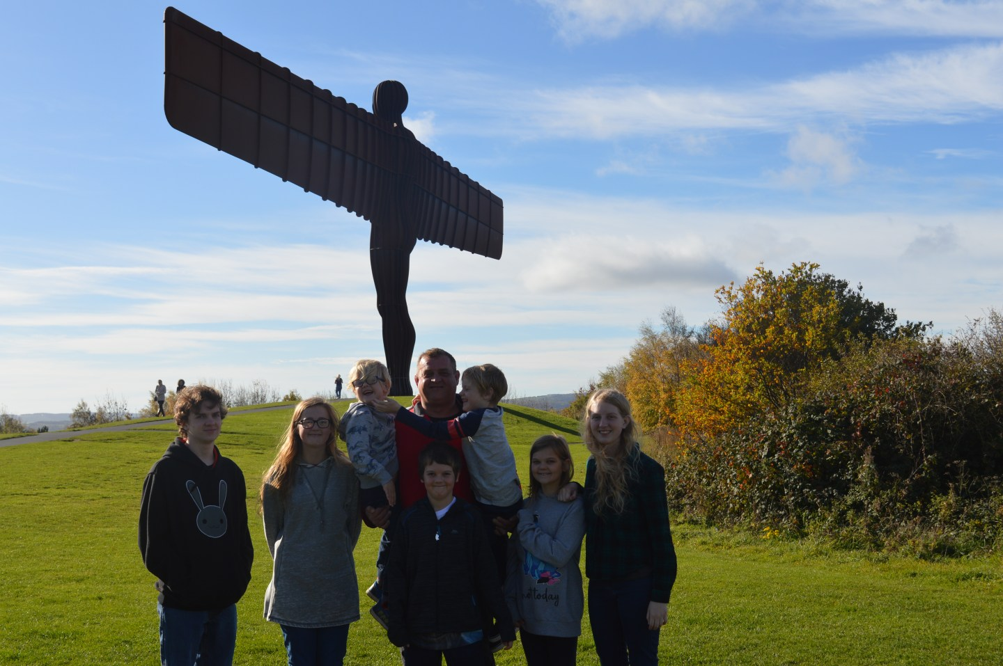 Family photo with angel of the north in the background on a A day trip to Newcastle