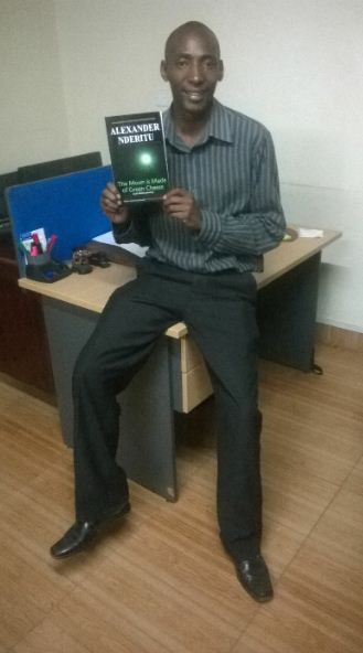 Alex Nderitu posing with his book | courtesy