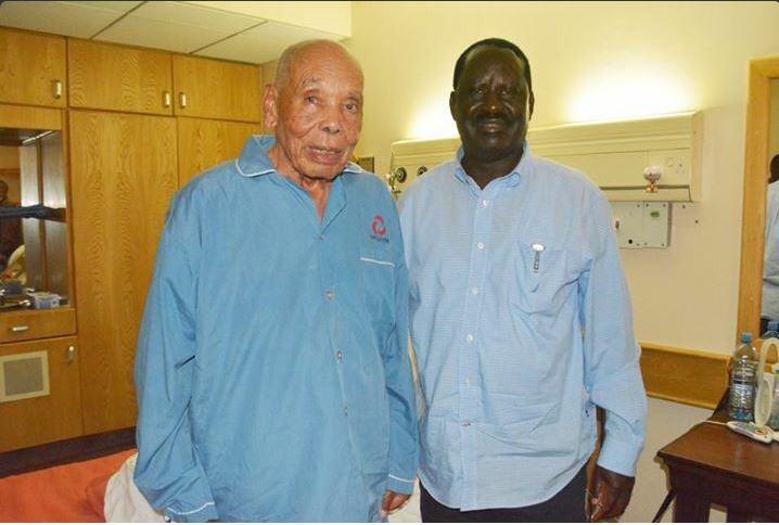 John Keen with Raila Odinga