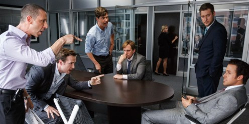 """This photo provided by Paramount Pictures shows, Jeremy Strong, from left, as Vinny Peters, Rafe Spall as Danny Moses, Hamish Linklater as Porter Collins, Steve Carell as Mark Baum, Jeffry Griffin as Chris and Ryan Gosling as Jared Vennett, in the film, """"The Big Short,"""" from Paramount Pictures and Regency Enterprises. (Jaap Buitendijk/Paramount Pictures via AP)"""